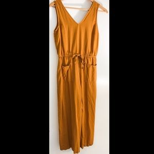 Orange jumpsuit with drawstring